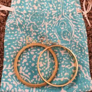 Lily Polzer gold bangle set with bag